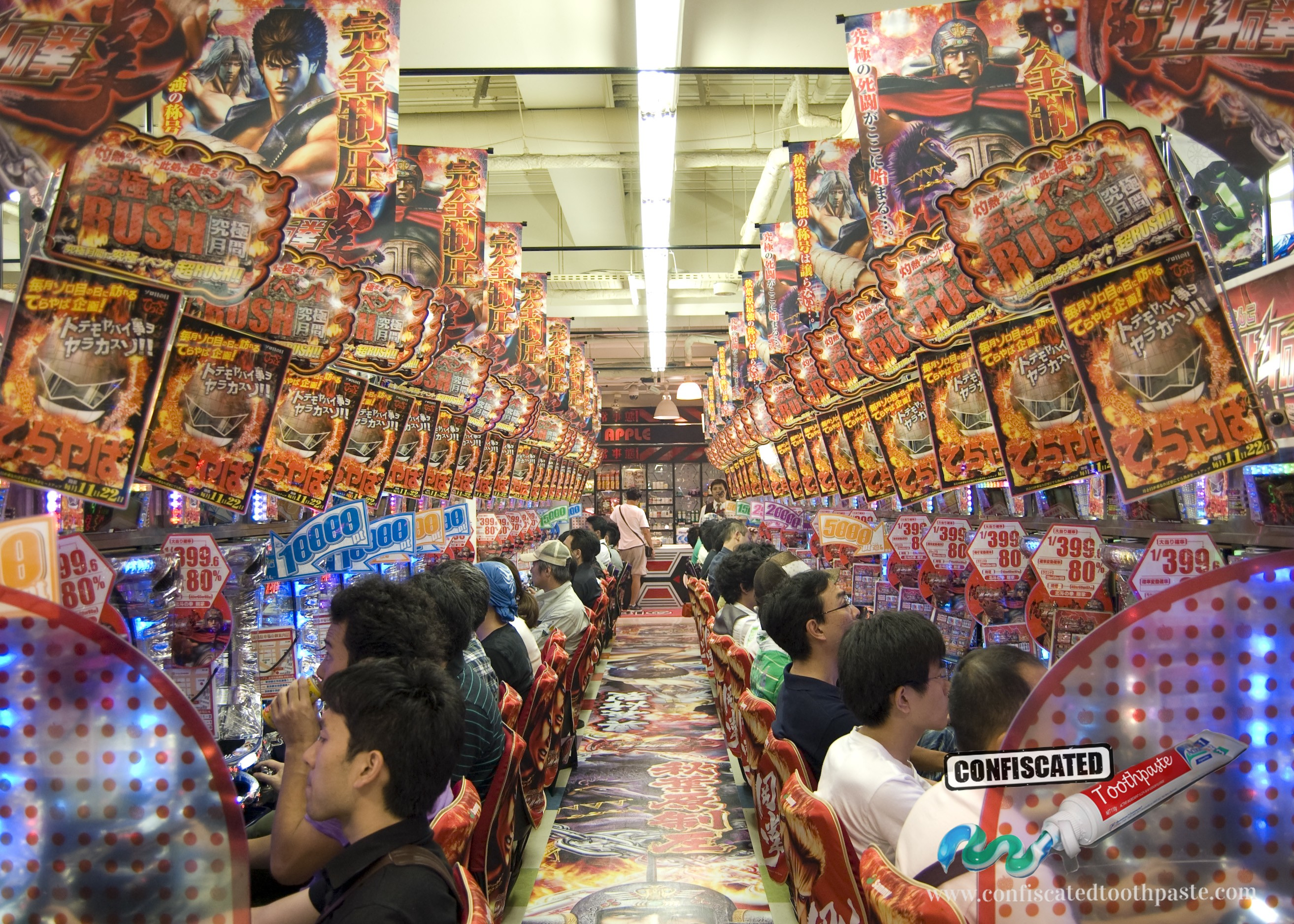 Pachinko parlour with rows of machines with colourful lights and gaudy music, Japan