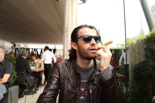 Trying to fit in with the cool cats in Milan.. I just hope they don't notice this cigar is actually a breadstick