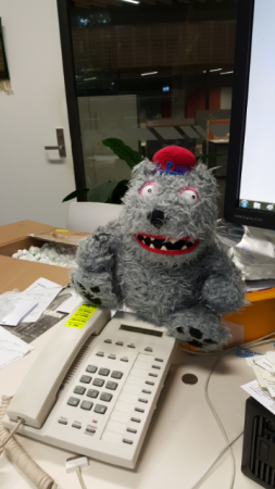 This is Charles the Car Monster, who has lived in my car for the past 10 years (pictured here on a rare excursion to my office), and is looking forward to my son's arrival almost as much as me.