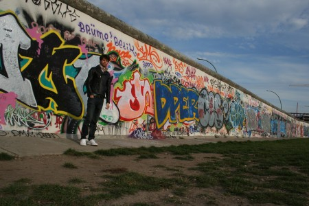 Standing in front of the Berlin Wall in Friedrichshein, Berlin. Where I am standing in this picture was actually in the death strip between the two walls- in the area where shoot to kill was authorised. Now it's a pleasant place to go for a stroll.